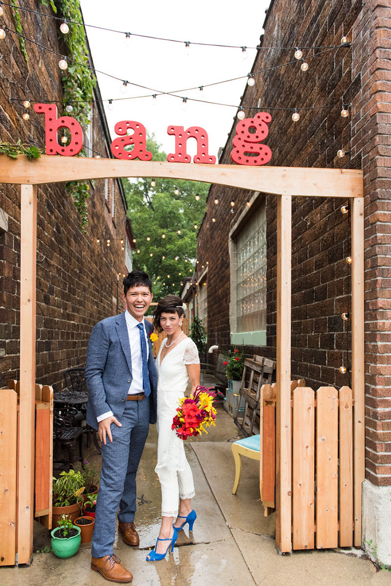 bride + groom bride in white jumpsuit