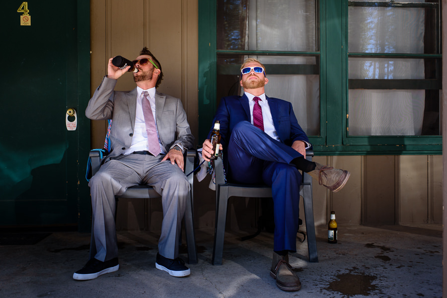 groomsman and groom sitting and drinking beer at Valhalla in Tahoe