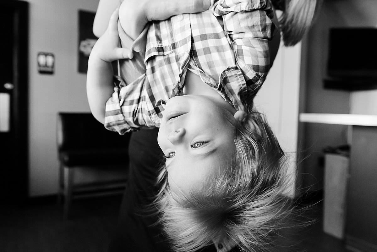 kiddo hanging upside down