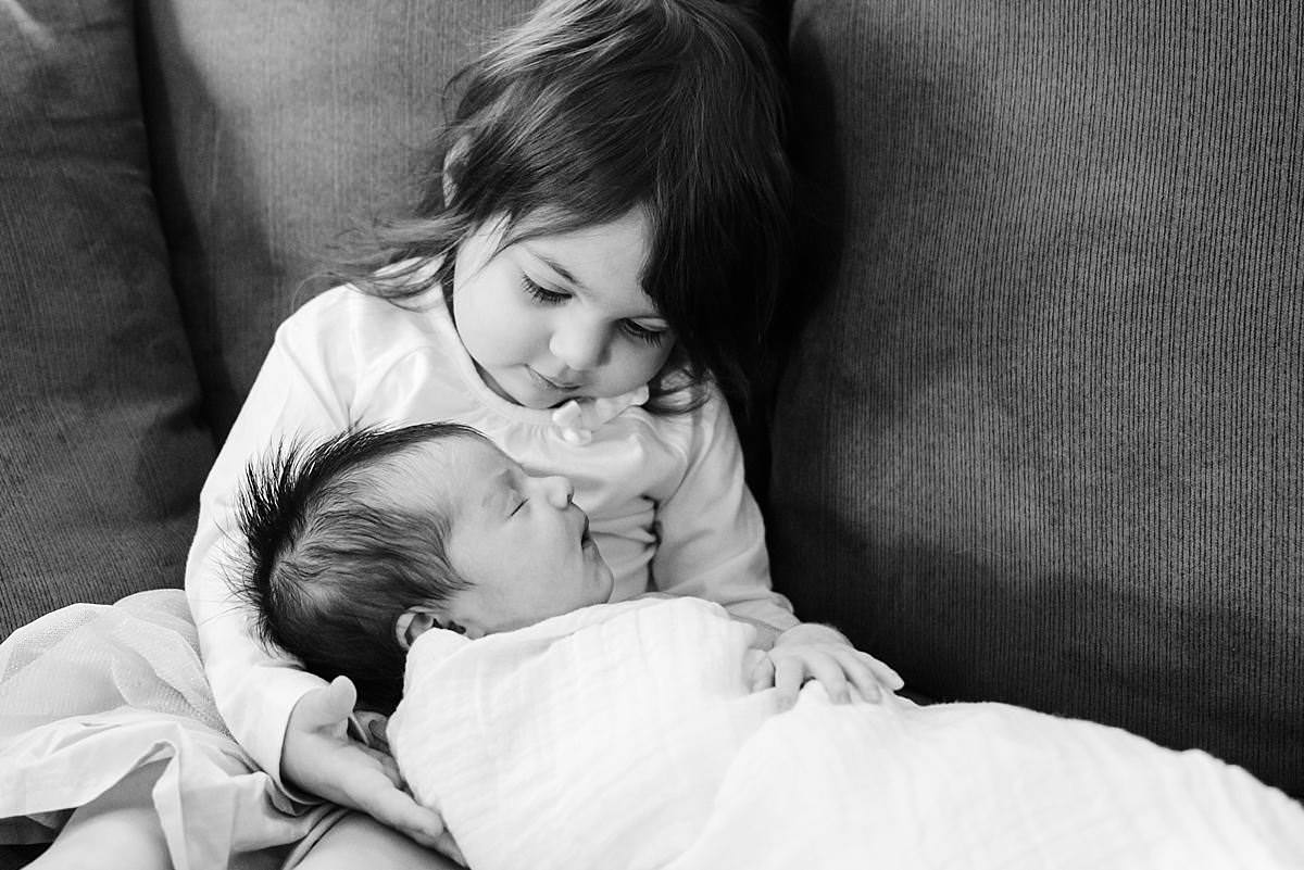 big sister and newborn little sister