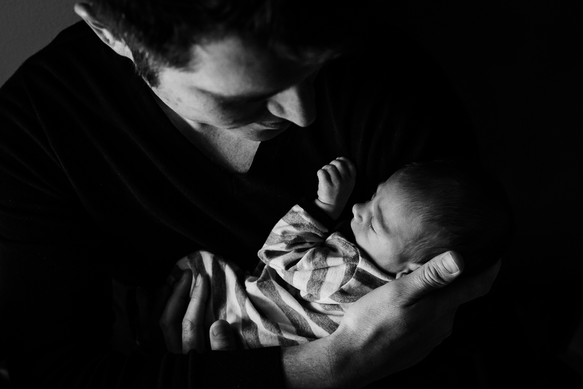 father and newborn baby in verona wisconsin