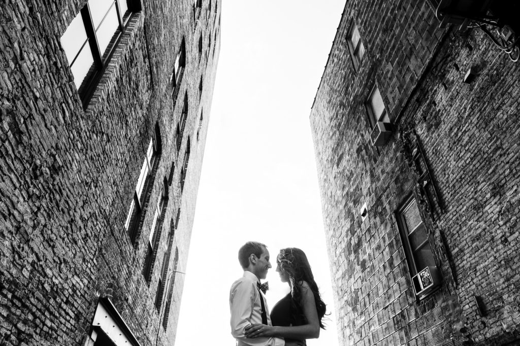 Milwaukee third ward engagement session between two brick buildings