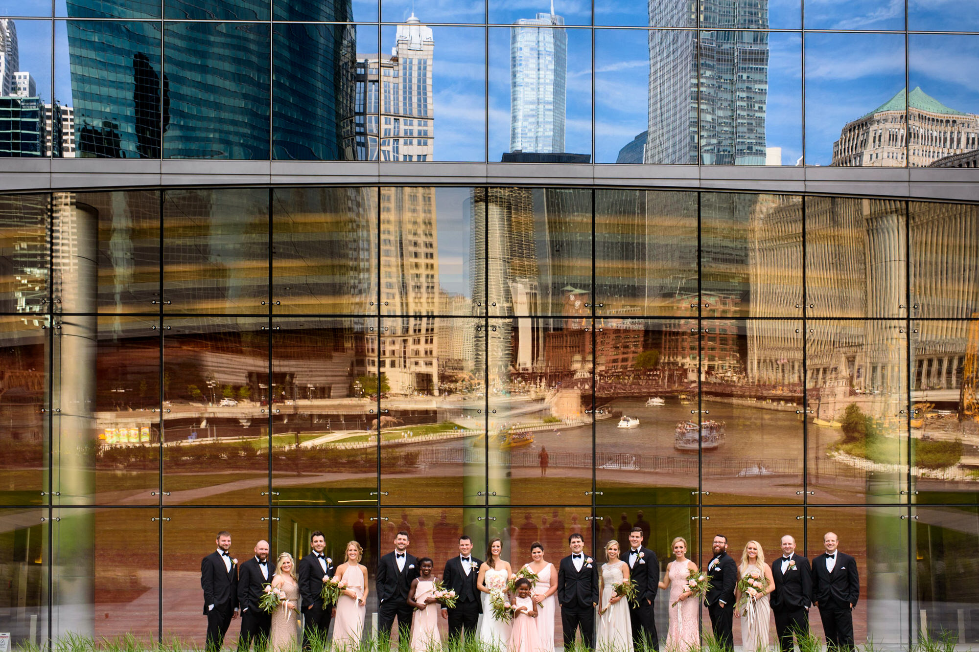 Chicago Wedding Party Posed in front of building on the riverwalk