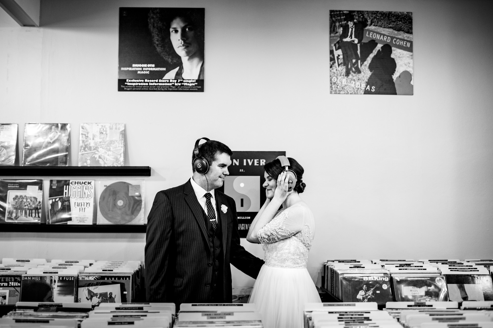 bride and groom listen to music on their wedding day at mad city music