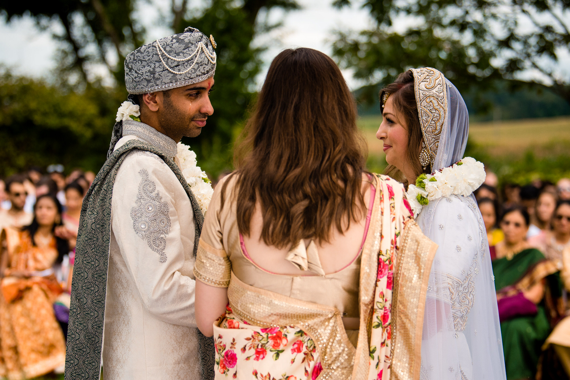 groom cries during outdoor wedding ceremony at Justin trails resort