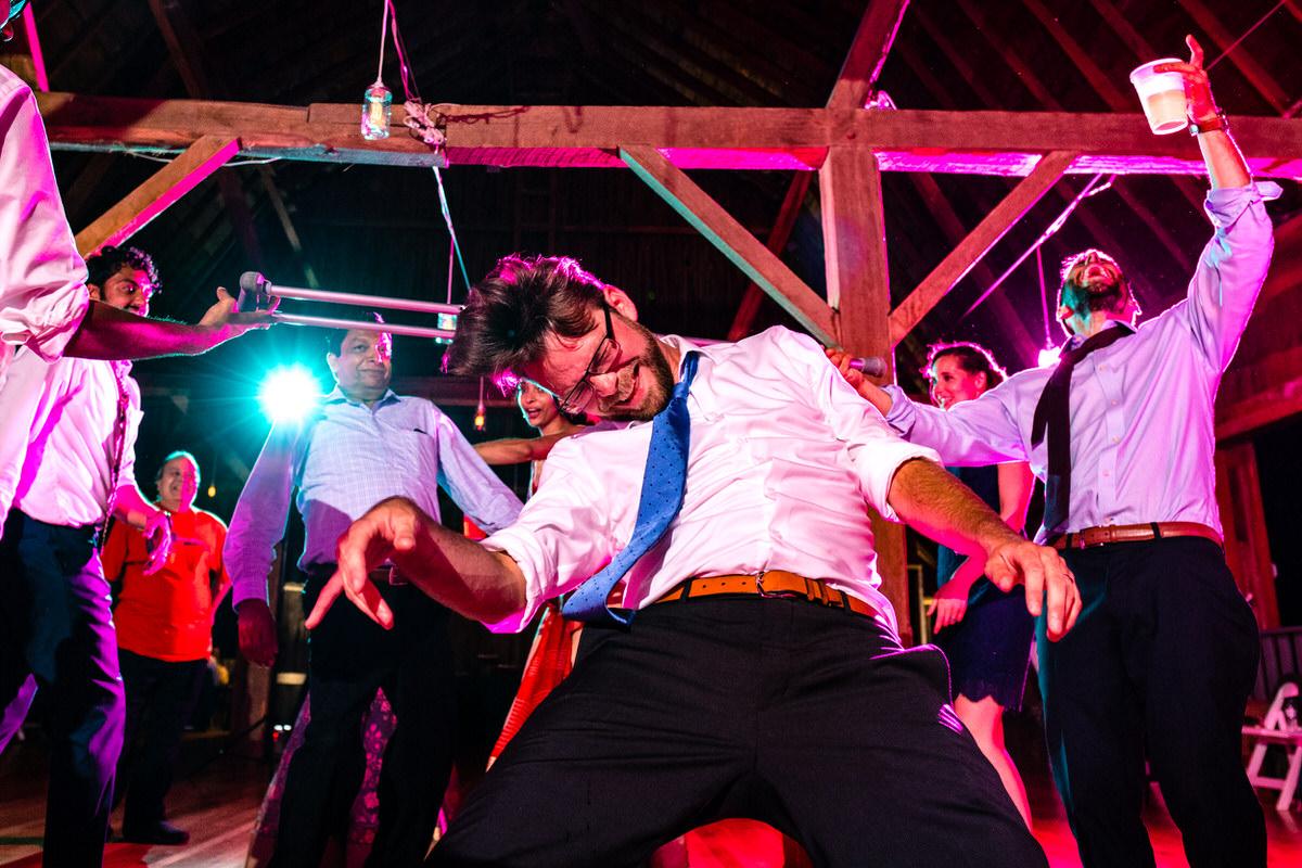 wedding dance limbo with groom's crutch