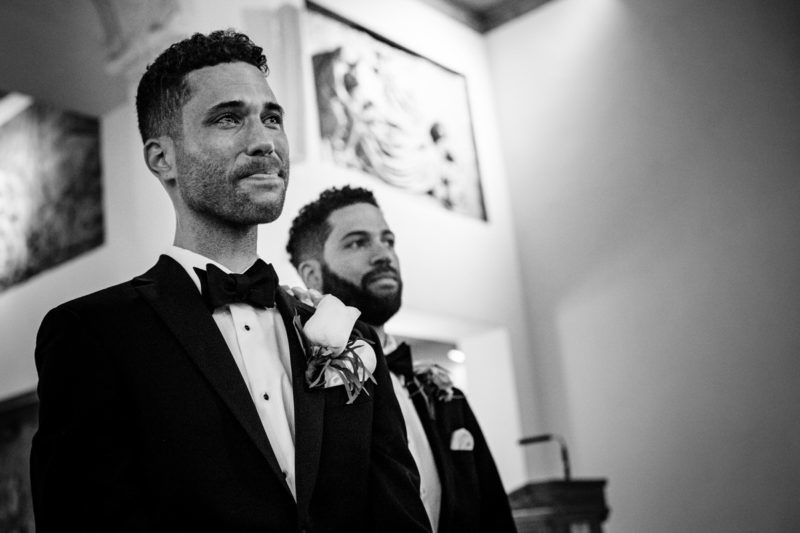 Groom crying as the bride walks down the aisle